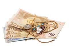 Monili e soldi Immagini Stock
