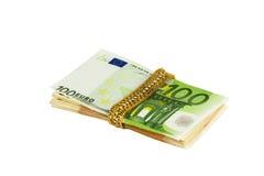 Monili e soldi Fotografie Stock