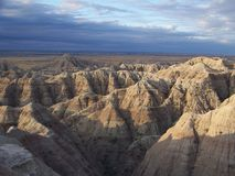 Moning Sun in the Badlands. Morning sun rising across the rock formations in The Badlands in South Dakota Royalty Free Stock Photos
