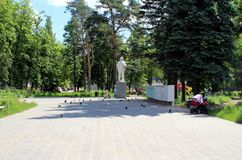 Monino. A young mother with a stroller rests near the monument to Lenin. Royalty Free Stock Photography