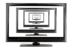 Moniteur de l'affichage à cristaux liquides TV avec beaucoup d'écrans d'isolement sur le blanc Images libres de droits