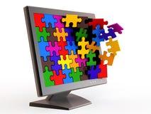 Moniteur et puzzle. Photographie stock