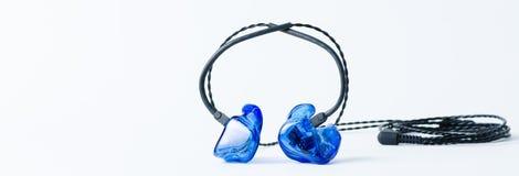moniteurs de Dans-oreille Images stock