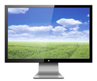 Monitor. Computer monitor with nature,green field with blue sky.  on white background Royalty Free Stock Photography