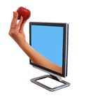 Monitor with a an apple Stock Image
