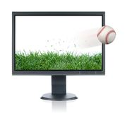 Monitor and baseball. LCD monitor and baseball isolated over a white background Royalty Free Stock Photo