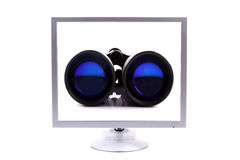 Monitor with binoculars Stock Images