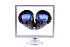 Monitor with binoculars Royalty Free Stock Photos