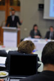 Conference. In progress. Monitor with blank space in focus and everything else in blur Royalty Free Stock Photography