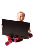 Monitor and a boy four years. Flat Panel Monitor on a white background and a boy four years Royalty Free Stock Photography