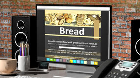 Monitor with Bread recipe on desktop Stock Image