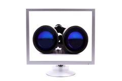 Monitor com binóculos Imagens de Stock