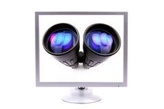Monitor con los prismáticos Fotos de archivo libres de regalías