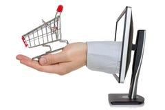 Monitor de computadora y mano con el carro de la compra imagen de archivo