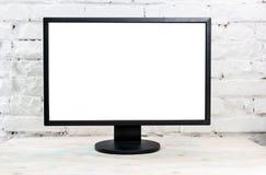 Monitor del computer su una tavola Immagine Stock Libera da Diritti