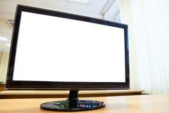 Monitor del computer su una tavola Fotografia Stock Libera da Diritti