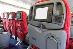 Monitor del LCD en el asiento de pasajero del plano de aire Imagen de archivo libre de regalías
