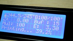 Monitor with digits work process 3d printer stock video footage