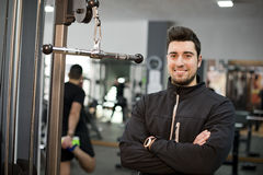 Monitor fitness trainer. Posing and smiling looking at camera Royalty Free Stock Photography