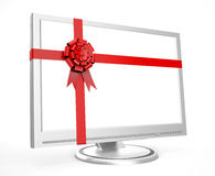 Monitor in a gift. Preparation for holidays. New year and christmas eve Royalty Free Stock Photos