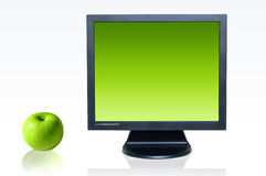 Monitor and green apple Stock Photography