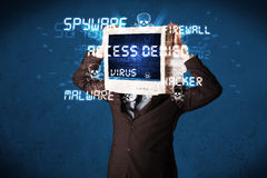 Monitor head person with hacker type of signs on the screen Stock Photo