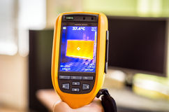 Monitor inspection with thermal camera. Thermovision camera inspects computer heat loss Royalty Free Stock Photo