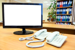 Monitor with isolated on white screen with telephones Royalty Free Stock Image