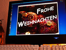 Monitor - light game - Frohe Weihnachten Stock Photography
