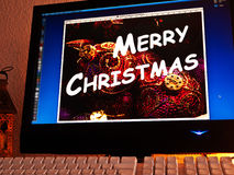 Monitor - light game - Merry Christmas Stock Photo