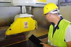 Monitor while machine cut marble stone Stock Photo