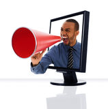 Monitor Megaphone. A computer flat screen monitor with a megaphone Royalty Free Stock Photography