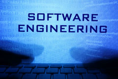 Monitor with message software engineering. Monitor with message software engineering and hands on a keyboard stock image