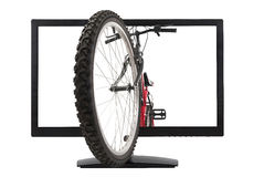 Monitor and mountain bike Royalty Free Stock Image