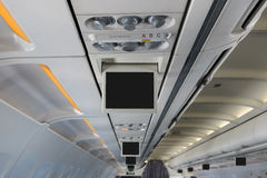 Monitor over head in airplane Royalty Free Stock Photo