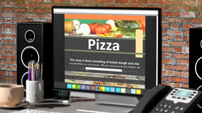 Monitor with Pizza recipe on desktop Royalty Free Stock Photos