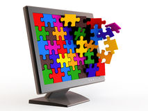Monitor and puzzle. Stock Photography