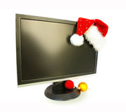 Monitor and Santa Claus hat Royalty Free Stock Photography