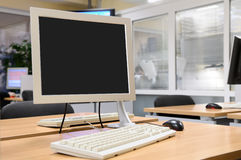 Monitor screen in office interior. Stock Photos
