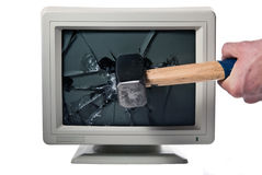 Monitor is smashed with a hammer Stock Photo