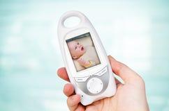 Monitor video del bebé para la seguridad del bebé Imagen de archivo