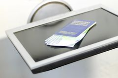 monitor on a white background but not . Keyboard blue passport and money dollars and euro Royalty Free Stock Images