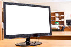 Monitor with white screen on table Royalty Free Stock Photo