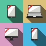 Monitor y tableta y teléfono móvil con las cintas Foto de archivo libre de regalías