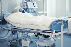 Monitoring of comatose patient in intensive care Stock Image