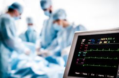 Monitoring of ECG and saturation O2 in the patient in the operating room. Monitoring of ECG and saturation O2 in the patient in the operating room during the Royalty Free Stock Image