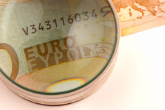Monitoring the Euro. Concept of financial market worries Royalty Free Stock Image