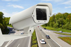 Monitoring. A highway with a video camera stock photos