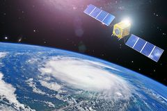 Monitoring hurricane. Satellite above the Earth makes measurements of the weather parameters and movement trajectory. Elements of