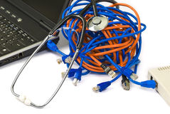 Monitoring network - concept. Magnifying glass and network cables Stock Images